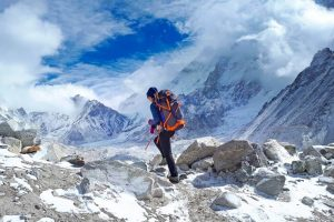 woman wearing Quechua backpack iwhile hiking Everest base camp