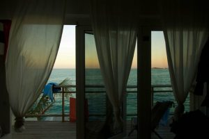 Bahasea Backpackers in Nassau Bahamas - interior of hostel room with balcony looking over ocean - The Country Jumper