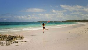 topless woman jumping on French Leave Beach Eleuthera Island The Bahamas - The Country Jumper