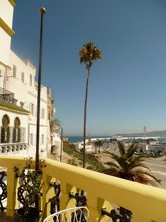 Study abroad in Morocco. Yellow porch overlooking the sea in Tangier