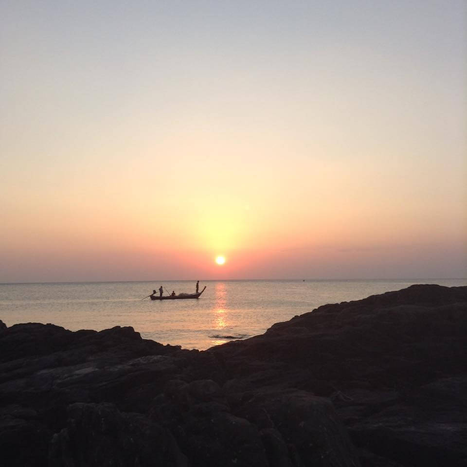 A sunset over the water off shore of Koh Lanta Thailand