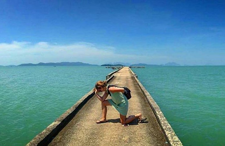 A pier reaching out into the sea at high tide on Koh Yao Noi