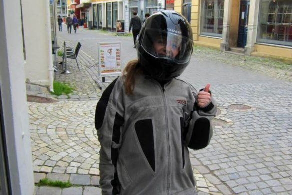 all dressed up in gear to go ride a motorcycle in norway