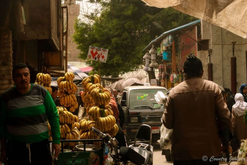 banana cart comes down street of people