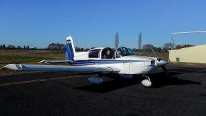 woman in single engine prop plane to explore australia