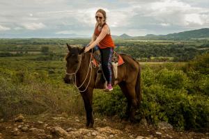 woman on horse in Trinidad cuba