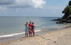 three women standing on a beach in Bali