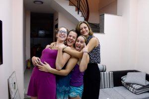four women hugging