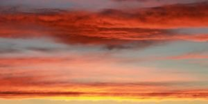 orange, yellow, purple, and red sunset sky