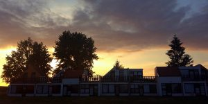 sunset behind row of accommodation buildings