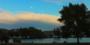 blue night sky with the moon and cloud over reservoir in south Moravia Czech republic
