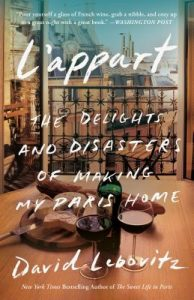 white writing across a photo of red wine on a balcony in Paris - l'aspart book cover