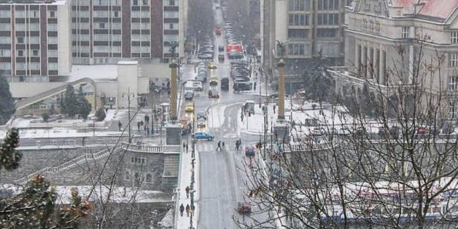 birds eye view of intersection in Prague covered with snow