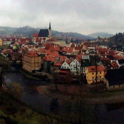 panorama of a river surrounded by a town with a prominent white church