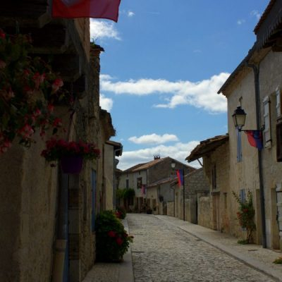 empty cobblestone street in Montjoi, France - The Country Jumper